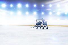 Złożony wizerunek gracze bawić się hokeja na lodzie obrazy royalty free