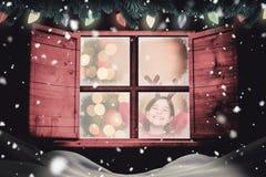 Złożony wizerunek jest ubranym poroże świąteczna mała dziewczynka Zdjęcie Royalty Free