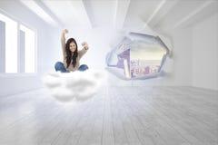 Złożony wizerunek kobieta patrzeje prosto naprzód gdy świętuje przed jej laptopem Fotografia Stock