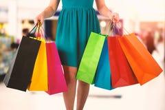 Złożony wizerunek kobiety trzyma torba na zakupy Obraz Stock