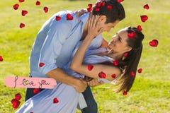 Złożony wizerunek kochający i szczęśliwy para taniec w parku Obrazy Stock