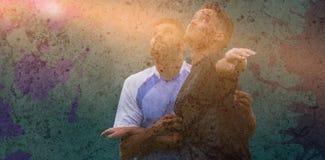 Złożony wizerunek kontakt przy futbolem fotografia royalty free