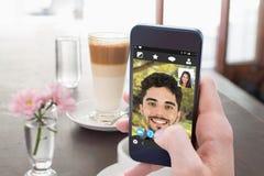 Złożony wizerunek latte i kawa na stole Fotografia Royalty Free