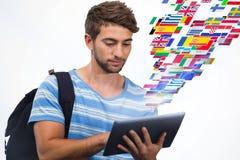 Złożony wizerunek męski student collegu używa cyfrową pastylkę Obrazy Stock