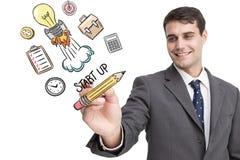 Złożony wizerunek młody biznesmena writing coś Obrazy Royalty Free