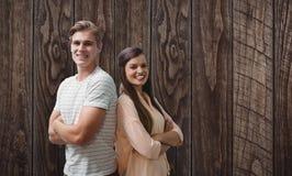 Złożony wizerunek młodzi uśmiechnięci ludzie pozuje z krzyżować rękami Zdjęcie Royalty Free