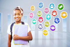 Złożony wizerunek małej dziewczynki mienia falcówki w szkolnym korytarzu Obrazy Royalty Free