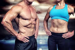 Złożony wizerunek midsection mięśniowy mężczyzna i kobieta z rękami na biodrze Fotografia Royalty Free