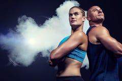 Złożony wizerunek niskiego kąta widok mięśniowy mężczyzna i kobieta Zdjęcie Royalty Free