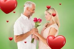 Złożony wizerunek oferuje jego partner róże czule mężczyzna Fotografia Stock