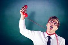 Złożony wizerunek ono dusi z telefonem geeky biznesmen Zdjęcie Stock