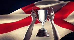 Złożony wizerunek pomyślny rugby gracza mienia trofeum Obraz Stock