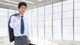 Złożony wizerunek portret biznesmen trzyma teczkę i jego kurtkę na jego ramieniu Obrazy Stock