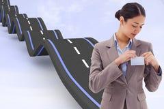 Złożony wizerunek portret bizneswoman przycina jej odznakę Fotografia Stock