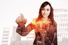Złożony wizerunek portret dotyka niewidzialnego ekran bizneswoman Zdjęcia Royalty Free
