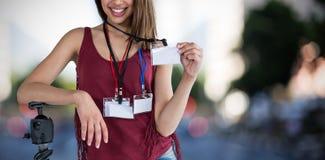 Złożony wizerunek portret szczęśliwy kobiety mienia dowód tożsamości zdjęcia stock