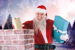 Złożony wizerunek portret umieszcza prezentów pudełka w komin Santa Claus Obrazy Royalty Free