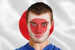 Złożony wizerunek poważny młody Japan fan z facepaint Obraz Royalty Free