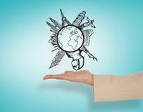 Złożony wizerunek przedstawia globalną podróży grafikę żeńska ręka Obrazy Royalty Free