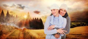 Złożony wizerunek przypadkowa para w ciepłej odzieży fotografia stock