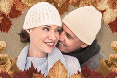 Złożony wizerunek przypadkowa para w ciepłej odzieży zdjęcia stock