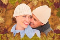 Złożony wizerunek przypadkowa para w ciepłej odzieży obrazy royalty free