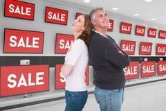 Złożony wizerunek przypadkowy pary uśmiechnięty i przyglądający up fotografia stock