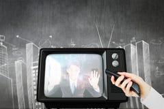 Złożony wizerunek ręka używać pilot do tv zdjęcia royalty free