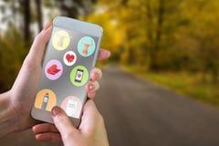 Złożony wizerunek ręki mienia smartphone Zdjęcia Royalty Free