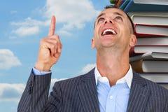 Złożony wizerunek rozochocony biznesmena wskazywać oddolny zdjęcie stock