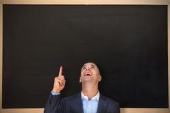 Złożony wizerunek rozochocony biznesmena wskazywać oddolny zdjęcia stock