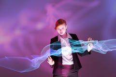 Złożony wizerunek rudzielec bizneswoman używa interaktywnego biurko zdjęcie royalty free