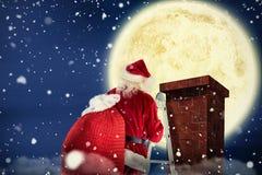 Złożony wizerunek Santa kroczy w górę drabiny Fotografia Stock