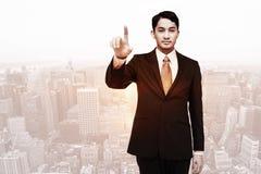 Złożony wizerunek srogo azjatykci biznesmena wskazywać Obrazy Stock
