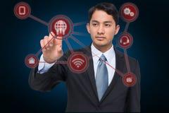 Złożony wizerunek srogo azjatykci biznesmena wskazywać Obraz Stock