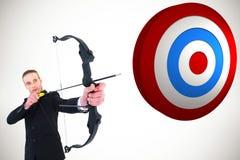 Złożony wizerunek strzela strzała i łęk skoncentrowany biznesmen zdjęcie stock