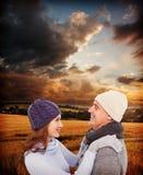 Złożony wizerunek szczęśliwa para w ciepłej odzieży fotografia royalty free