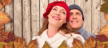 Złożony wizerunek szczęśliwa para w ciepłej odzieży obraz stock