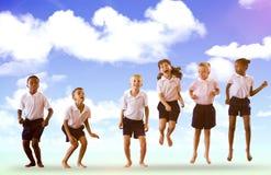 Złożony wizerunek szczęśliwi ucznie w mundurkach szkolnych zdjęcie royalty free
