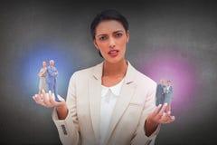 Złożony wizerunek trwanie poważny biznesmen popierać z kobietą z powrotem Zdjęcia Stock