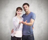 Złożony wizerunek trzyma out ich ręki para Fotografia Royalty Free