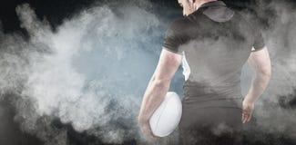 Złożony wizerunek twarda rugby gracza mienia piłka Zdjęcie Royalty Free