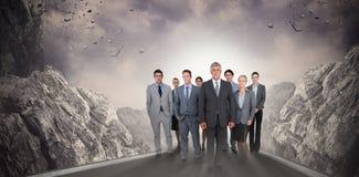 Złożony wizerunek uśmiechnięta biznes drużyna patrzeje kamerę zdjęcia royalty free