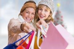 Złożony wizerunek uśmiechnięte kobiety patrzeje kamerę z torba na zakupy Obraz Royalty Free