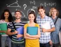 Złożony wizerunek ucznie trzyma falcówki w szkole wyższa zdjęcia stock