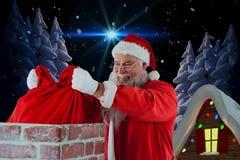 Złożony wizerunek umieszcza boże narodzenia Santa Claus zdojest w komin Zdjęcie Royalty Free