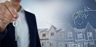Złożony wizerunek w połowie sekcja bizneswomanu seansu domu klucz zdjęcie royalty free