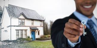 Złożony wizerunek w połowie sekcja pokazuje nowego domu klucz biznesmen zdjęcia royalty free