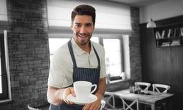 Złożony wizerunek wskazuje filiżankę kawy kelner Obraz Stock