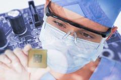Złożony wizerunek zakończenie żeński chirurga mienia procesor Zdjęcie Royalty Free